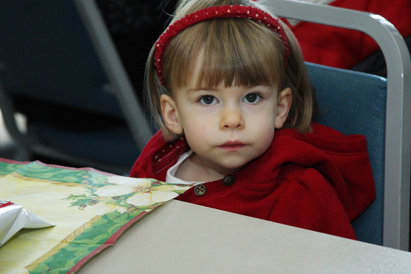 Cassidy Lee waits patiently for lunch and a chance to visit with Santa.