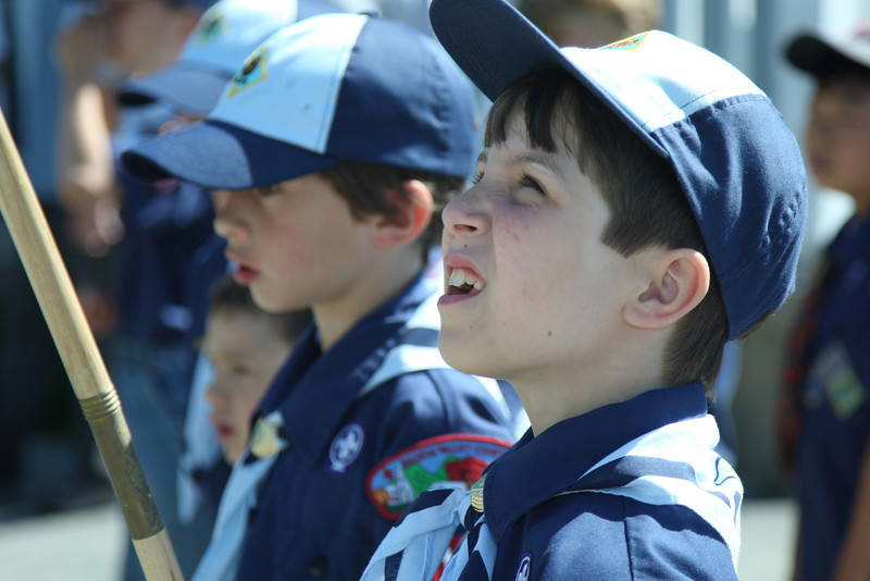 Dylan Molnar looks up at his flag as he waits to march in the Memorial Day Parade.