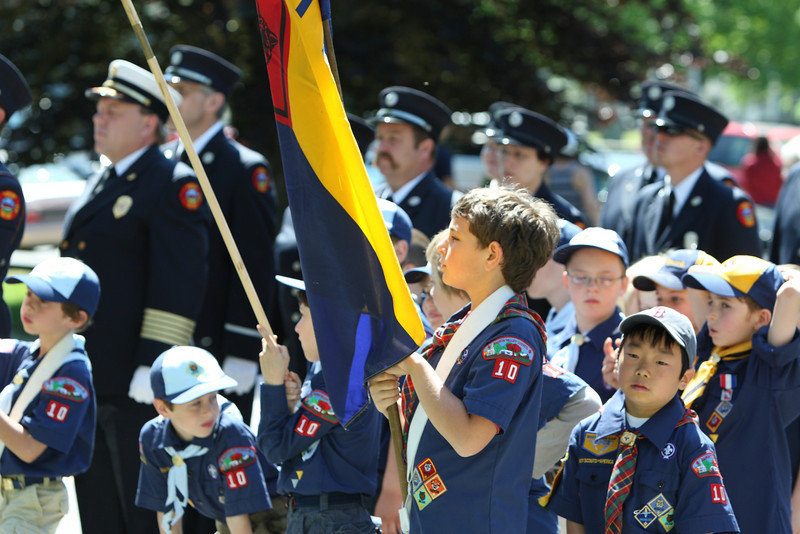 Cub scouts and fire fighters listen to the Memorial Day address.