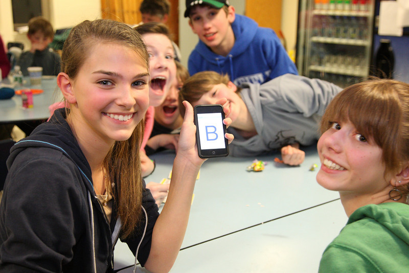 "Natalie Hara and Alicia Vellante pretend to be electronically tied into the bingo game with a ""B"" displayed on an Ipod touch."