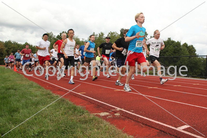 Racers sprint off the block at the Harvard Conservation Trusts' Race for the Hills on a 5K course that sent them through the woods behind McCurdy track on Lancaster County Road on Sept. 12.