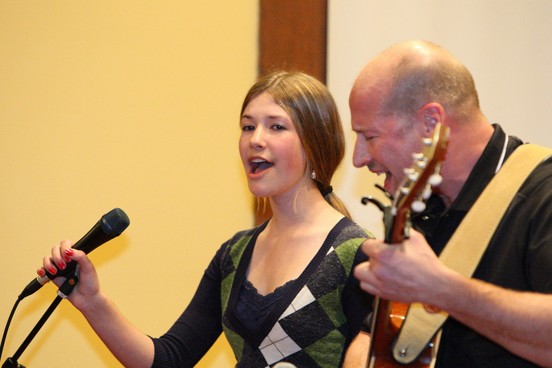 "Emma Noyes and her father, Ted, perform ""We are Predators All,"" an original composition of Ted's at the talent show held in Volunteers Hall last weekend. (Photo by Lisa Aciukewicz)"