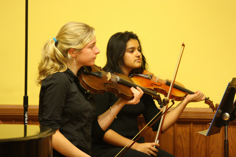Sarah Collins and Ann Chacko play violin as part of a Bromfield string quartet during a Thanksgiving Concert at Volunteers Hall. (Photo by Lisa Aciukewicz)
