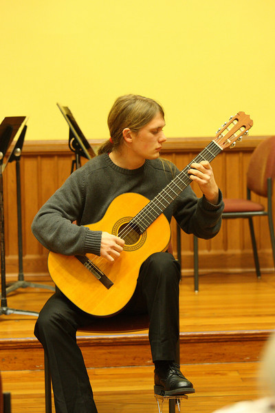 Kyle Quarles plays classical guitar as part of a Thanksgiving concert held in Volunteers Hall. (Photo by Lisa Aciukewicz)
