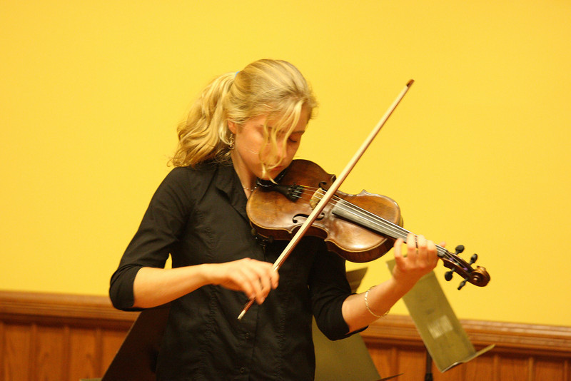 Sarah Collins plays violin as part of a Thanksgiving concert held in Volunteers Hall. (Photo by Lisa Aciukewicz)