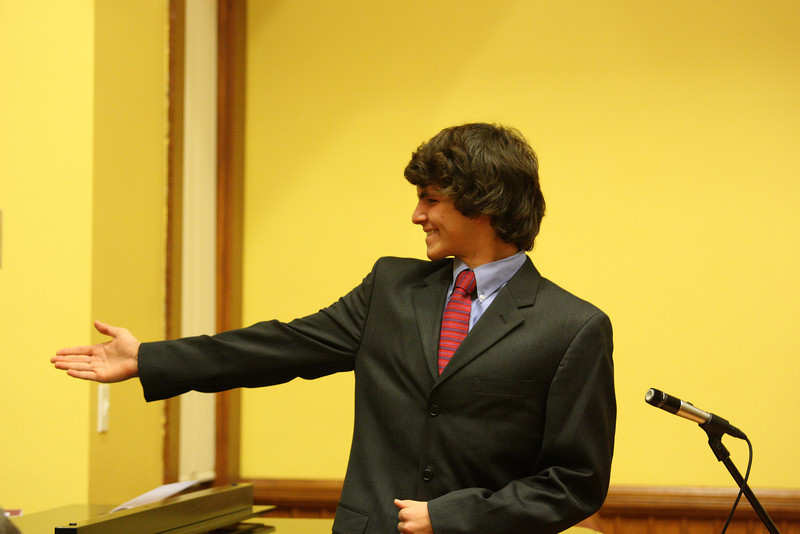 Tyler Alderson motions to Justin Bartlett, his accompaniest in a Thanksgiving concert held in Volunteers Hall. (Photo by Lisa Aciukewicz)