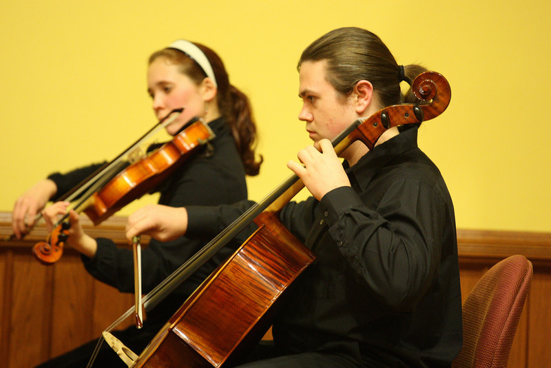 Kristina Kronauer and Graeme Buell peform as part of a Bromfield string quartet during a Thanksgiving concert held in Volunteers Hall last Friday. (Photo by Lisa Aciukewicz)