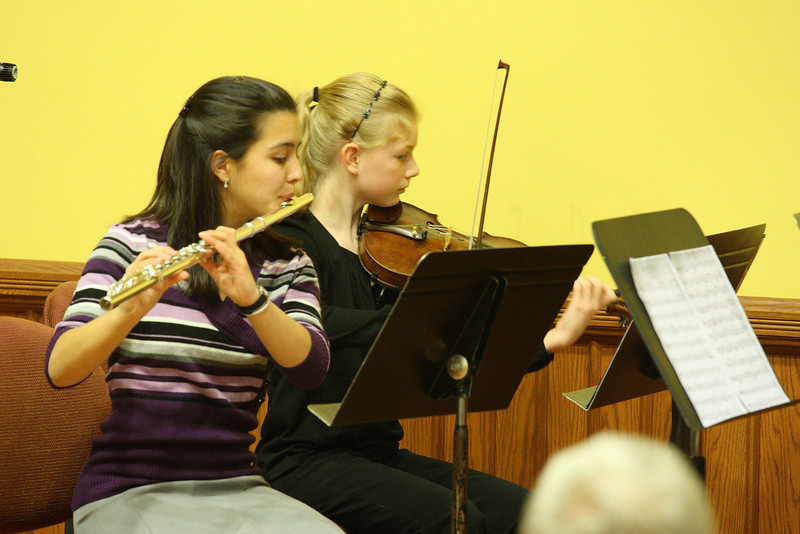 Lizzie Douglas and Kate Arndt perform in a flute quartet as part of a Thanksgiving concert held in Volunteers Hall. (Photo by Lisa Aciukewicz)