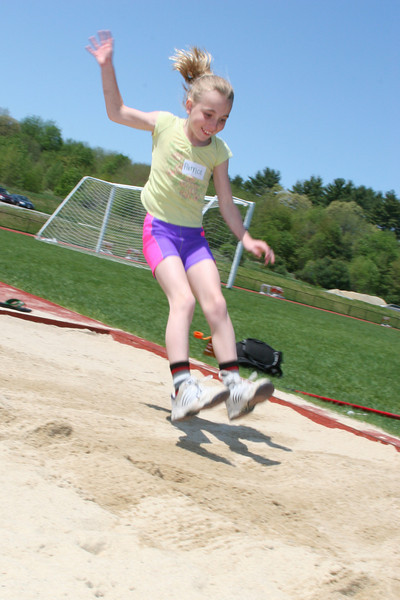 Patrice Mitchell tries out the long jump at a field day designed by Emily Huber to teach elementary school childen about track and field. (Photo by Lisa Aciukewicz)