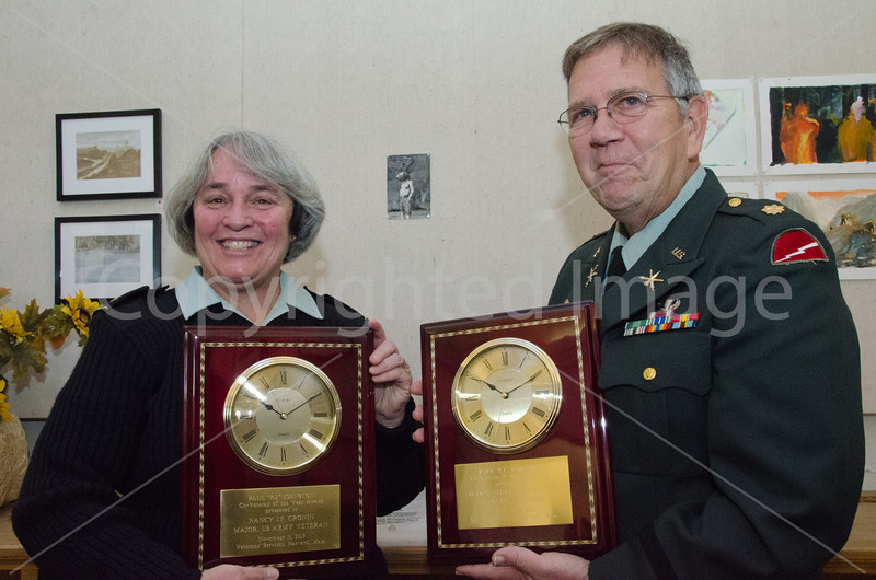 Major Nancy Cronin and husband Steve Cronin display their Veterans of the Year Awards
