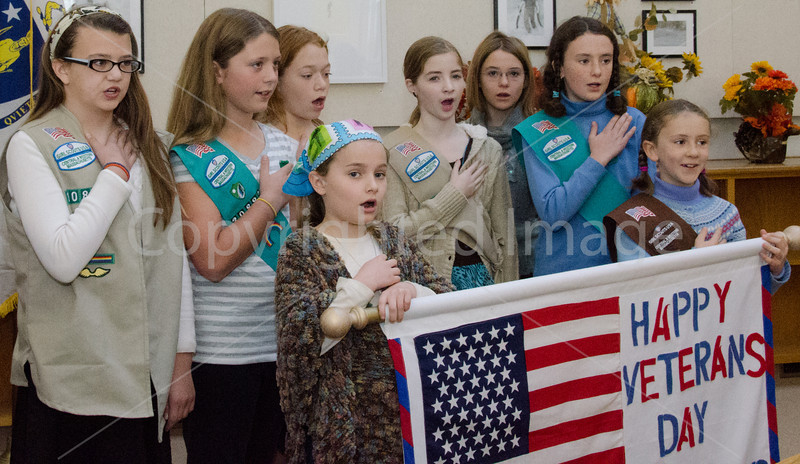 Girl scouts Bridget Kennedy, Arianna Thornton, Shea Oldham, Meghan Neville, Brianna Schmoyer, Tessa McClain, Lucy Richards, Ella Richards open the ceremony with the pledge of allegiance