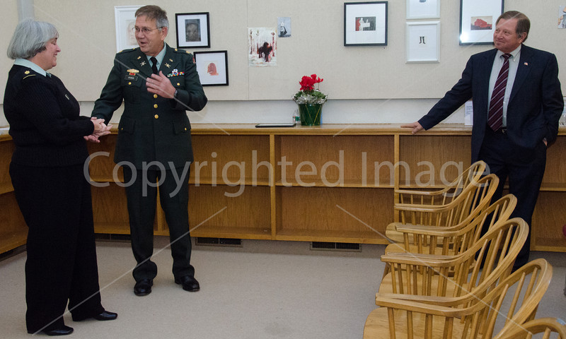Major Steve Cronin presents his wife Major Nancy Cronin