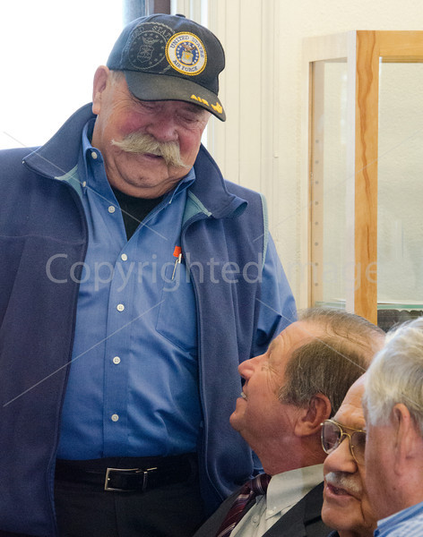 Korean War Veteran Nelson Northern chats with Ron Ricci.  Jim De Zutter sits to Ricci's right.