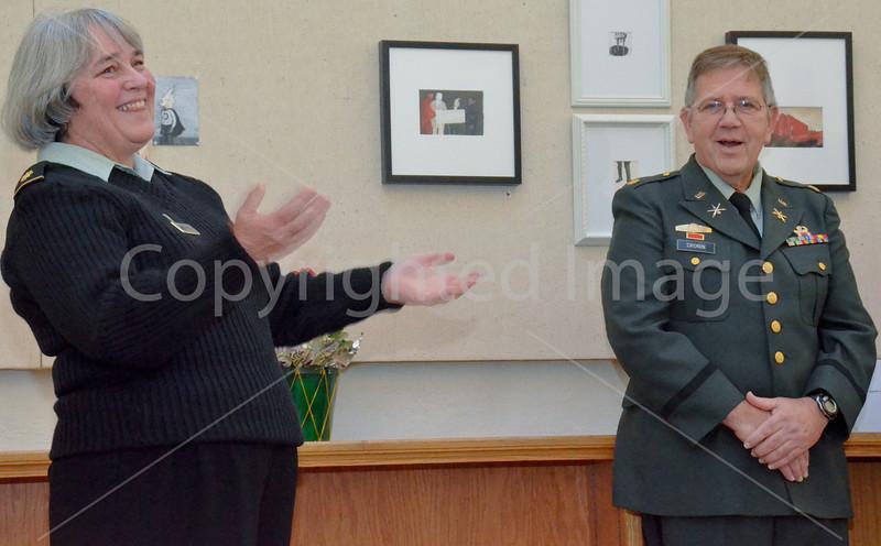 Major Nancy Cronin presents her husband Major Steve Cronin