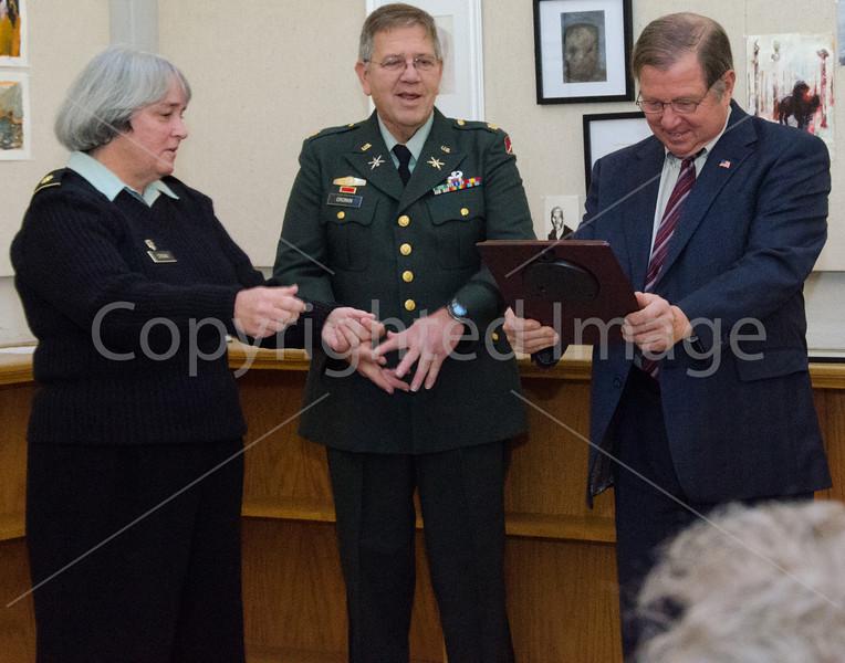 Ron Ricci presents veteran of the year award to Major Nancy Cronin