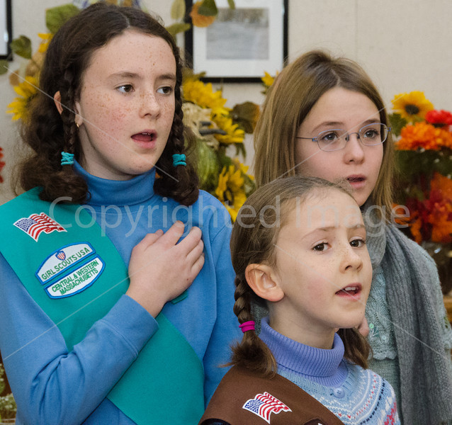 Girl scouts Lucy Richards, Ella Richards, Tessa McClain leading the pledge of allegiance