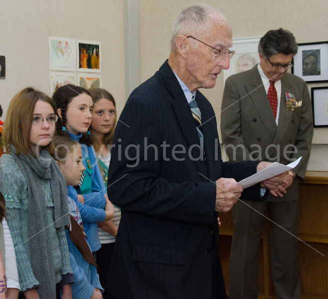 Pete Johnston says the closing prayer with girl scouts Tessa McClain, Ella Richards, Lucy Richards, Arianna Thornton looking on, and Dennis Lyddy on the right