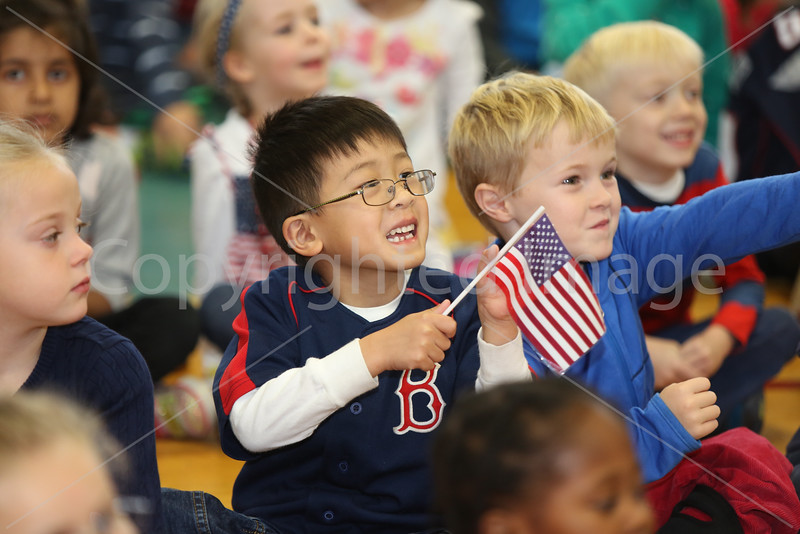 Kindergarteners Justin Qian and Edward Ells wave enthusiastically.