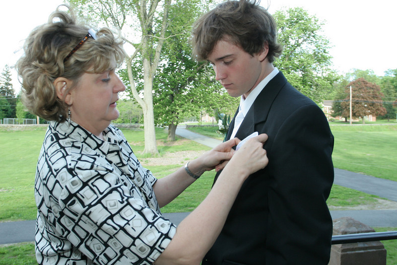 Pat Wahlberg fixes the buttonaire on son Kyle's tuxedo in front of Old Bromfield before the junior-senior prom on Friday night.