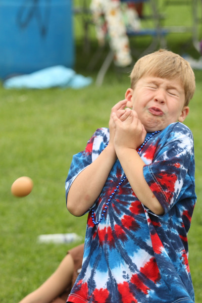 Chris Pickereign almost catches his egg in the fourth of July activities in front of Old Bromfield.