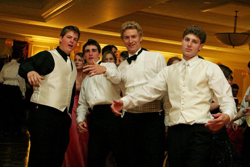 Alex Harrah, Connor Mackenzie, Ben Brown and Josh Lyvers pause on the dance floor.