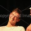 Sam Hayes wets Jamie Barretts hair before cutting it.