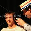 Sam Hayes gives Jamie Barrett a hair cut.