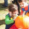 Thomas and Callia Sintros enjoy pumpkin decorating.