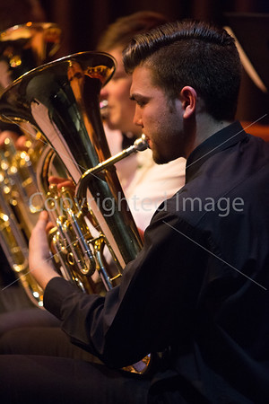 Ben Neville, a teaching assistant for the 7/8th grade band plays the euphonium during their concert.