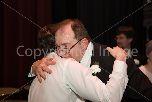 Tom Reynolds embraces Josh Fishbien after the preformance