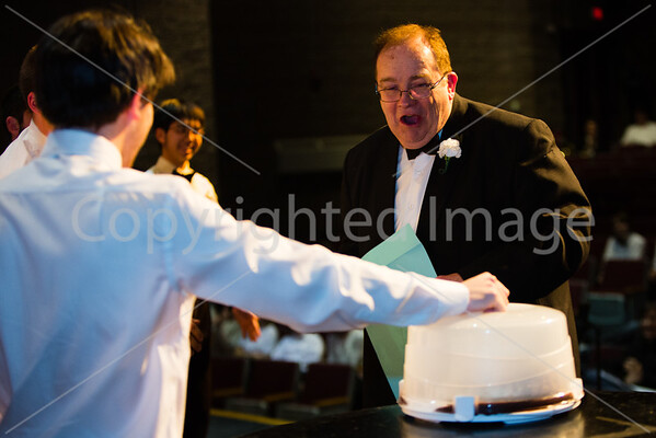 Josh Fishbien shows Mr. Reynolds a home made Boston Creame Pie.