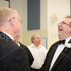 Tom Reynolds laughs with his fith grade band conductor Mr.Schuller.