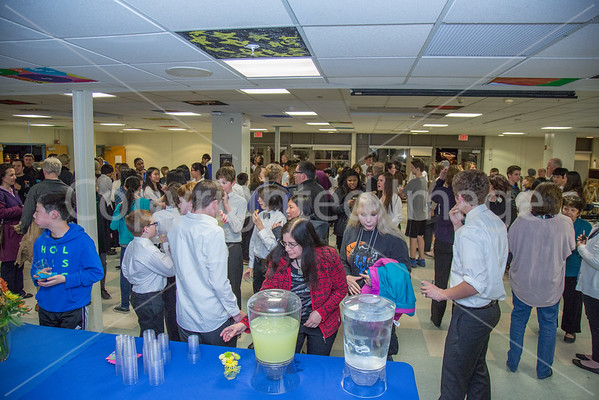 Guests attend a reception after the preformance to congratulate Mr.Reynolds on his 17 years of service.