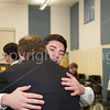 Tom Reynolds embraces Joey Calabresi after the preformance.