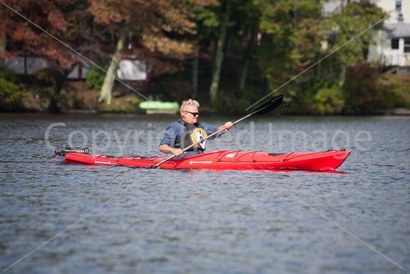 Bob Porter finishing 3rd in Mens Kayak