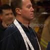 David Hazel wearing tickets around his neck awaiting the next raffle