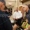 Fire Cheif Rick Sicard helps tear apart raffle tickets.