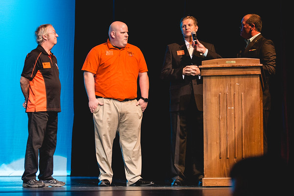 From left, Harvest Homecoming president Bradley Needham, president elect Drew Jones, and board chairman Bradley Needham address the audience at their pageant on Saturday.