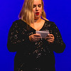 Harvest Homecoming queen contestant Breanna Harsha reads an original piece of writing about the reality of panic attacks during the pageant on Saturday.