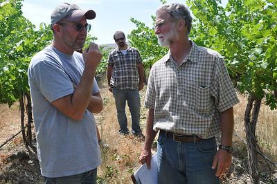 Scott Williams of Kiona Vineyards speaks with Bob Betz, while assistant winemaker Tyson Schiffner listens in.