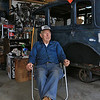 "Harvey Price, 93, talked about making cider for 80 years. Called a ""legendary beverage in Lunenburg"" he makes it with a press that is over 100 years old. a 1931 model A sits behind him as he talked about his dad, family and cider making in his garage. SENTINEL & ENTERPRISE/JOHN LOVE"