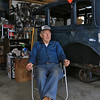 """Harvey Price, 93, talked about making cider for 80 years. Called a """"legendary beverage in Lunenburg"""" he makes it with a press that is over 100 years old. a 1931 model A sits behind him as he talked about his dad, family and cider making in his garage. SENTINEL & ENTERPRISE/JOHN LOVE"""