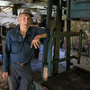 """Harvey Price, 93, talked about making cider for 80 years. Called a """"legendary beverage in Lunenburg"""" he makes it with a press that is over 100 years old. Here he talks about the cider while standing next to the over 100 year old press. SENTINEL & ENTERPRISE/JOHN LOVE"""