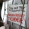 """Harvey Price, 93, talked about making cider for 80 years. Called a """"legendary beverage in Lunenburg"""" he makes it with a press that is over 100 years old. Thisa sign sitis in the shed wher he makes the cider. SENTINEL & ENTERPRISE/JOHN LOVE"""