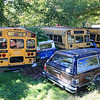 """Harvey Price, 93, talked about making cider for 80 years. Called a """"legendary beverage in Lunenburg"""" he makes it with a press that is over 100 years old. These three buses sit in his yard along with many other vehicles. SENTINEL & ENTERPRISE/JOHN LOVE"""