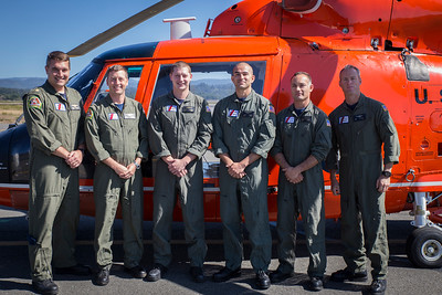 From left to right, Coast Guard Sector Humboldt Bay crew members Lt. Derek Schramel, Lt. Neil Romans, flight mechanics Jeff Bothman, Ruben Ramirez, Brent Alexander and rescue swimmer Nick Gardner stand in front of a Coast Guard helicopter on September 27, 2017.  (Sam Armanino - The Times-Standard)
