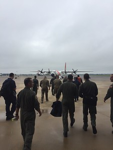 The Coast Guard Sector Humboldt Bay crew walks out to board an aircraft which flew straight through Hurricane Harvey in late August.  (Lt. Derek Schramel  - Contributed)