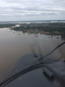 Coast Guard Sector Humboldt Bay pilot Lt. Derek Schramel said some of the most challenging parts of flying in the hurricane was attempting to hover below power lines, between trees and close enough to addresses to locate stranded people.  (Lt. Derek Schramel  - Contributed)