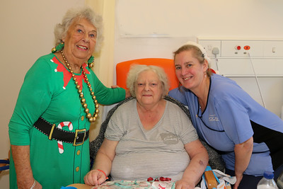 25 DEC 2019 – Pictured: Betty Holbrook MBE (Vice Chair, H&D Fellowship for the Sick), with patient Brenda Tague and Penny Townsend (HCA) - Harwich & District Fellowship for the Sick Christmas Gifts – Trinity Ward, Harwich Fryatt Hospital, Dovercourt. – Photo Copyright © Maria Fowler 2019