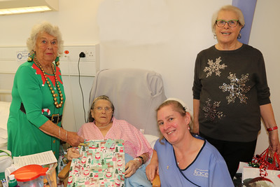 25 DEC 2019 – Pictured: Betty Holbrook MBE (Vice Chair, H&D Fellowship for the Sick), with patient Brenda Oliver, Penny Townsend (HCA) and Sheena Parson (Hon Secretary, H&D Fellowship for the Sick) - Harwich & District Fellowship for the Sick Christmas Gifts – Trinity Ward, Harwich Fryatt Hospital, Dovercourt. – Photo Copyright © Maria Fowler 2019
